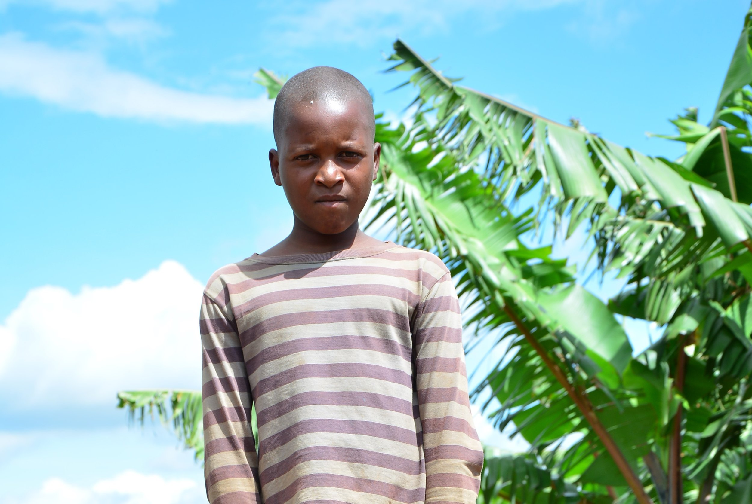Meet David Niyogisubizo, a 12-year-old boy currently enrolled in school because of Seven United's support