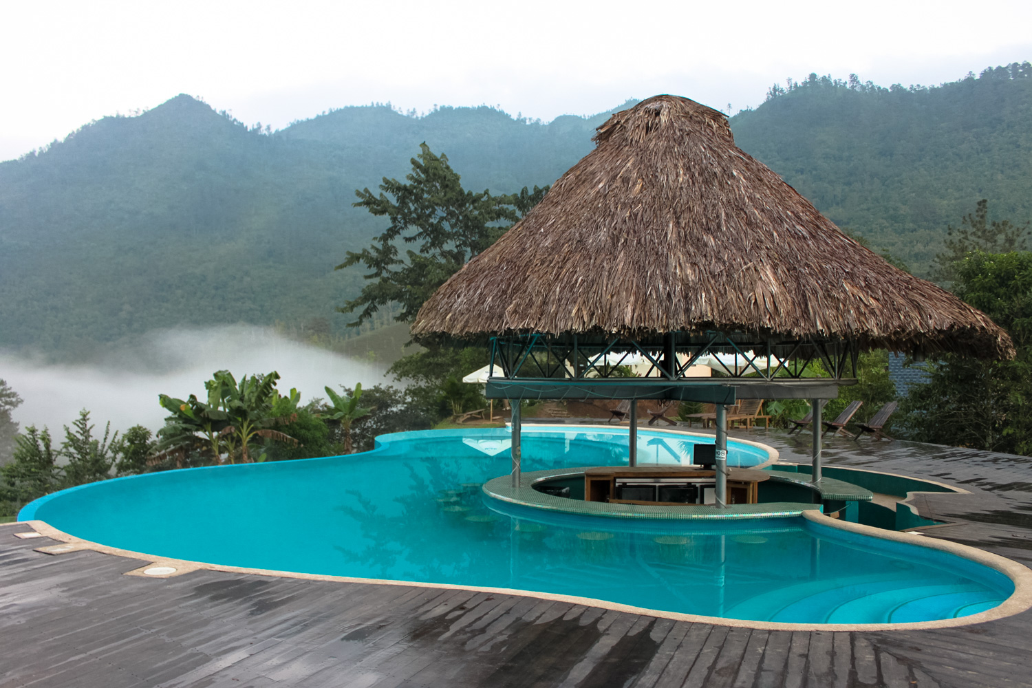 Hostel in the middle of the jungle with infinity pool and sundeck.  Zephyr Lodge - Lanquin, Guatemala