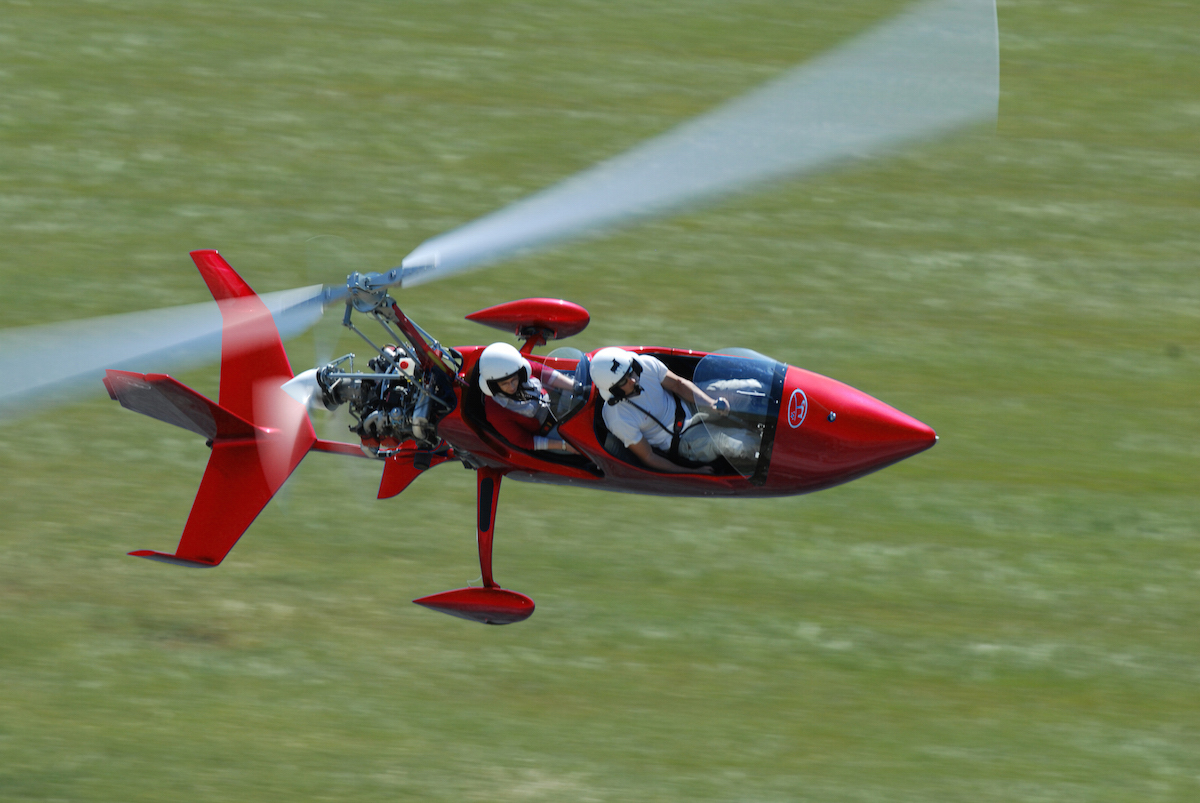 gyrocopter autogiro red low-flying