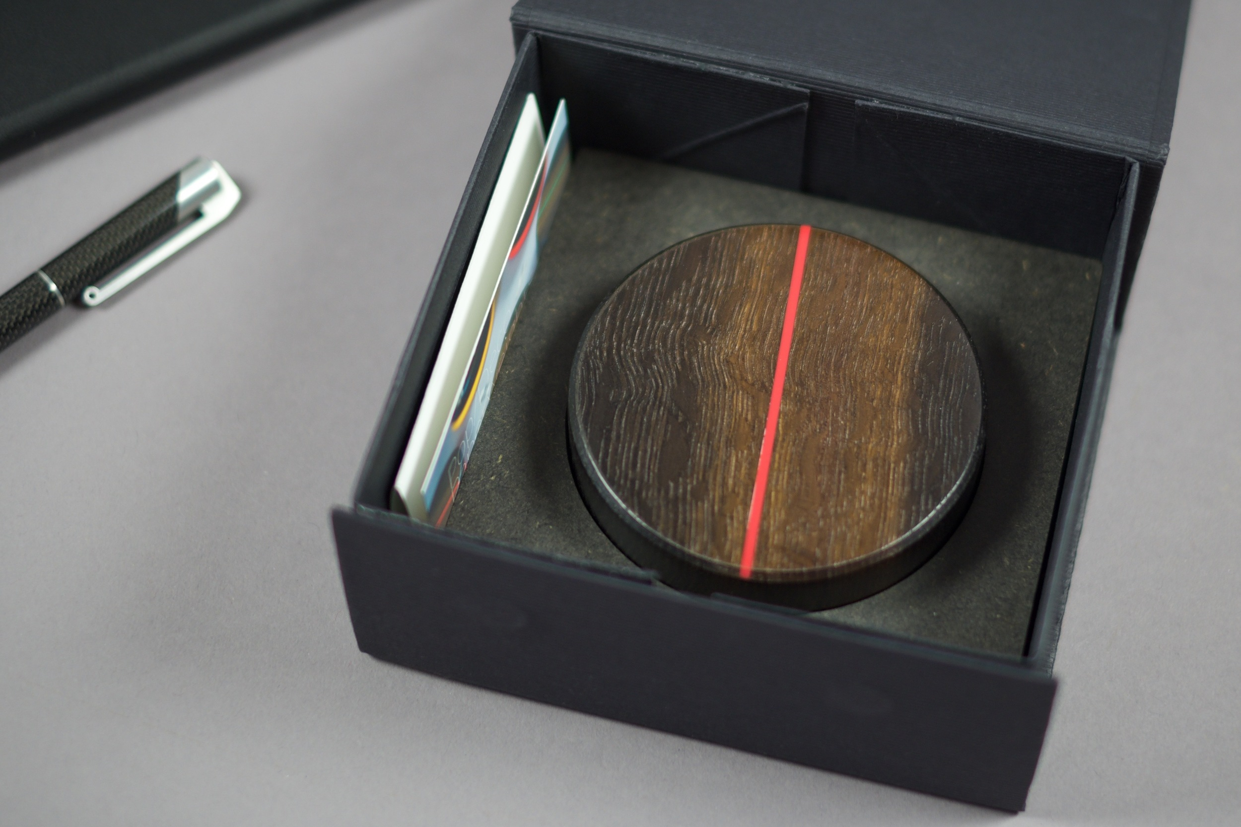 The Paperweight is presented and held in place by a twin layer of colour matching Valchromat. The box also contains a small printed leaflet outlining the materials used.