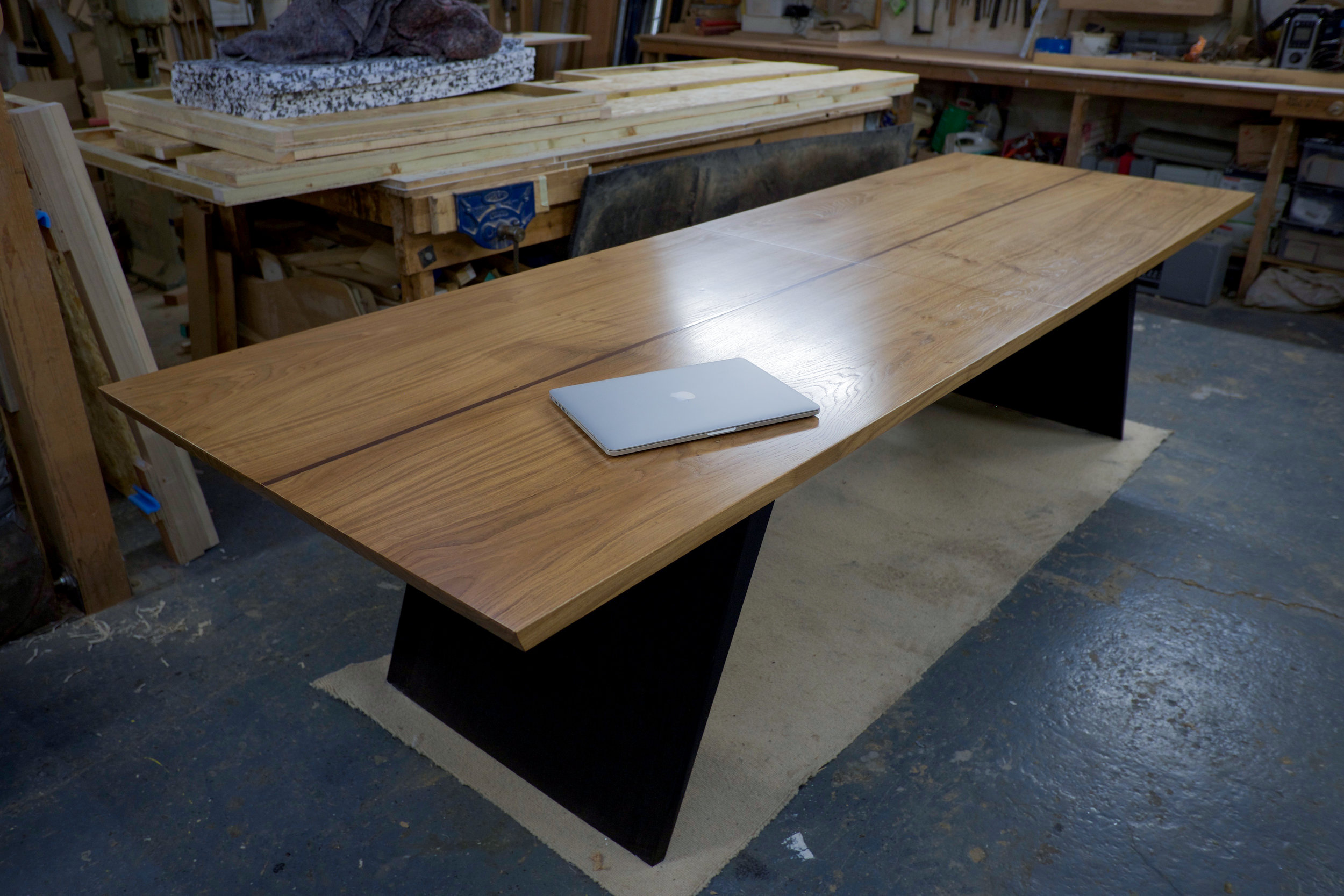 The Blade Dining Table - with the extending section folded away