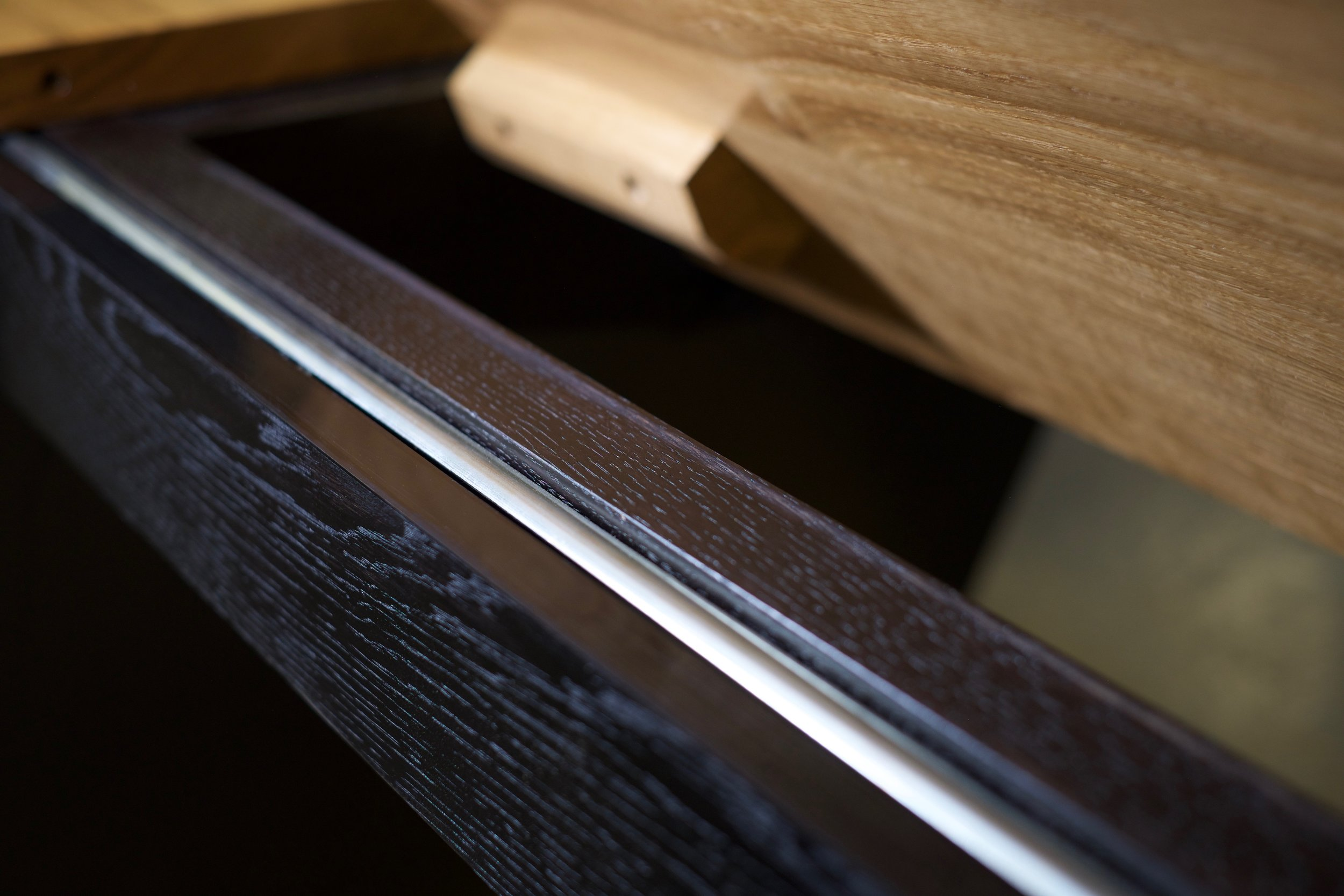Detailed shot of the ebonised oak frame