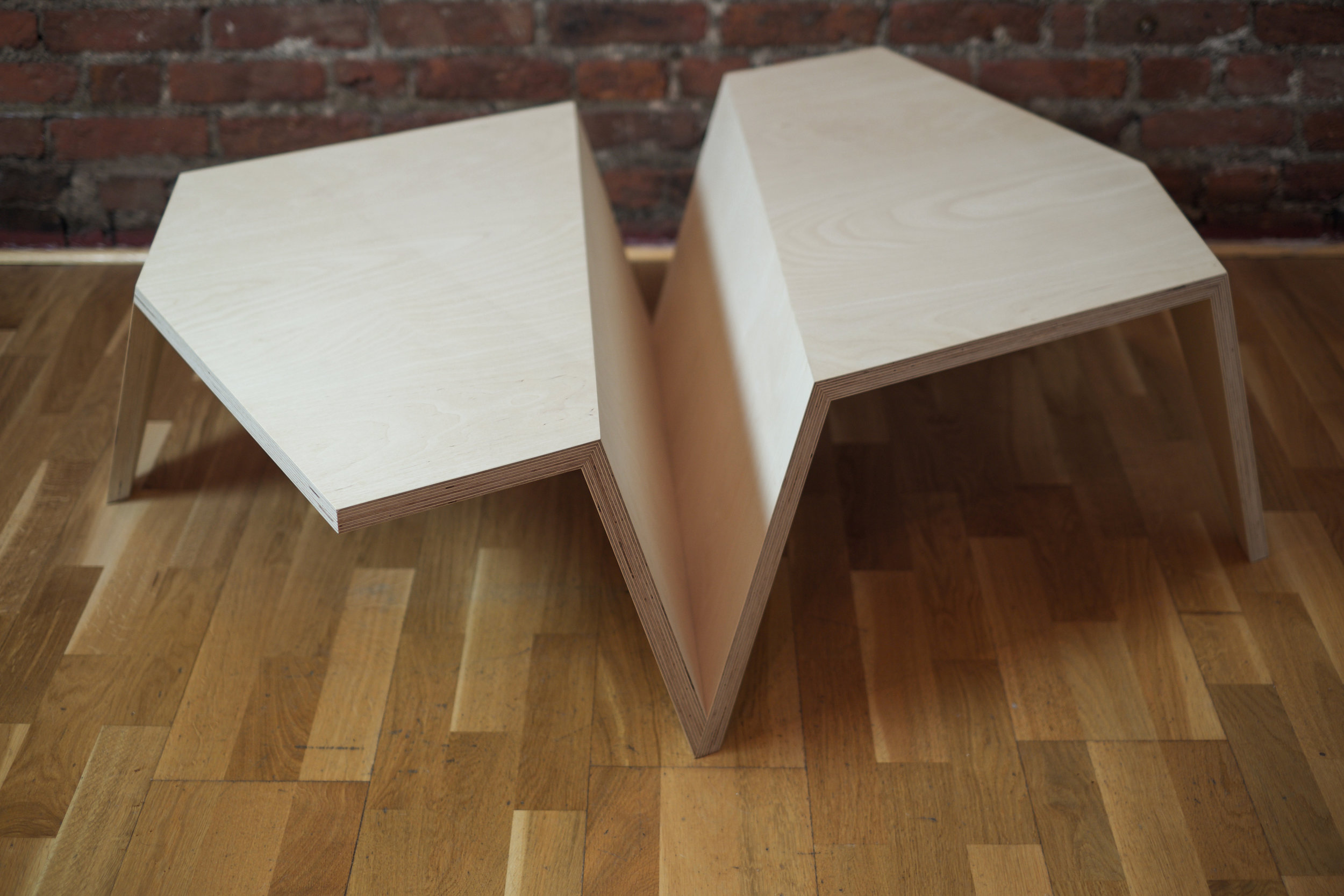 The Origami Low Coffee Table in Beech Ply - detailing the 'V' storage section