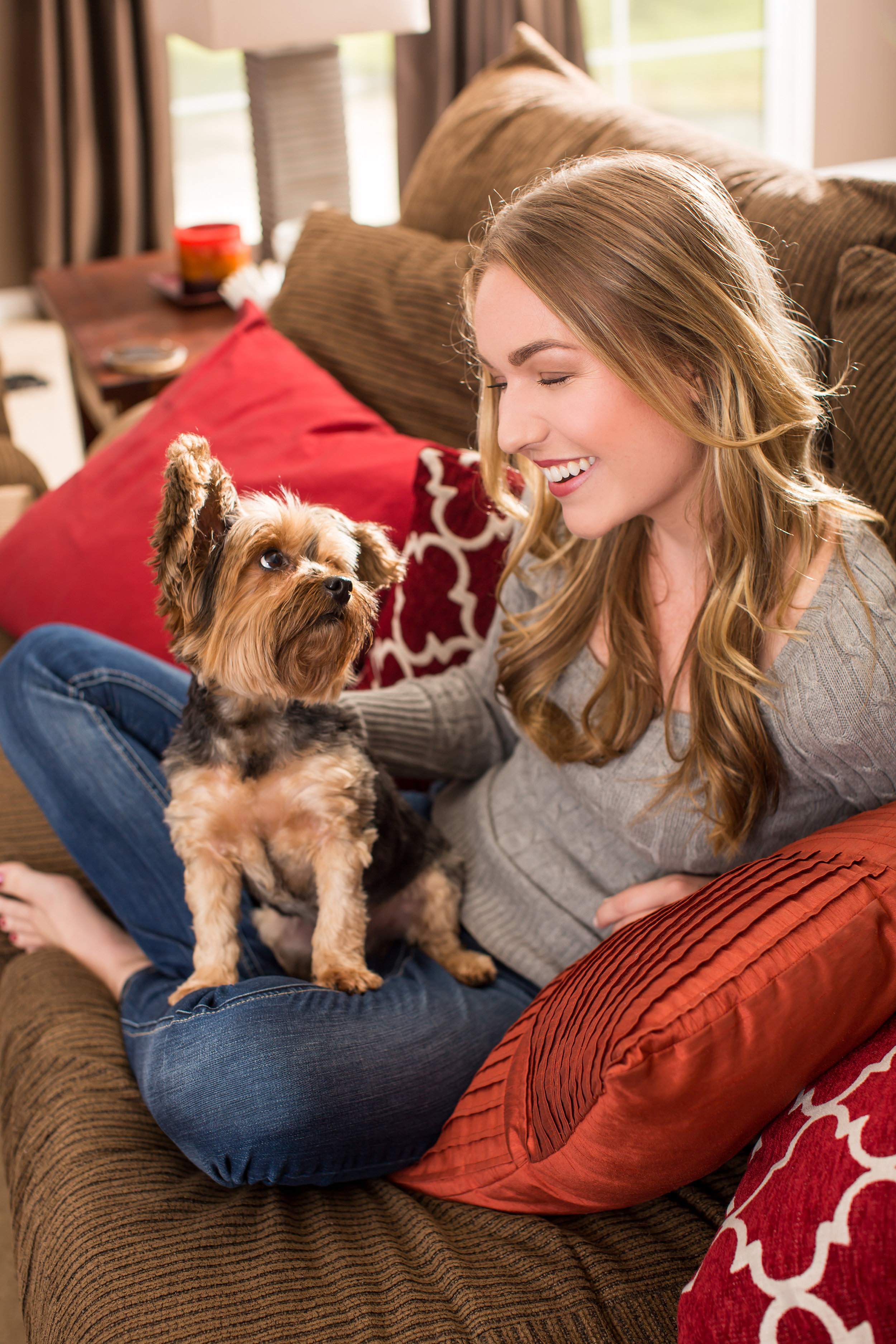 Depositphotos_pet sitter on couch with Yorkie.jpg