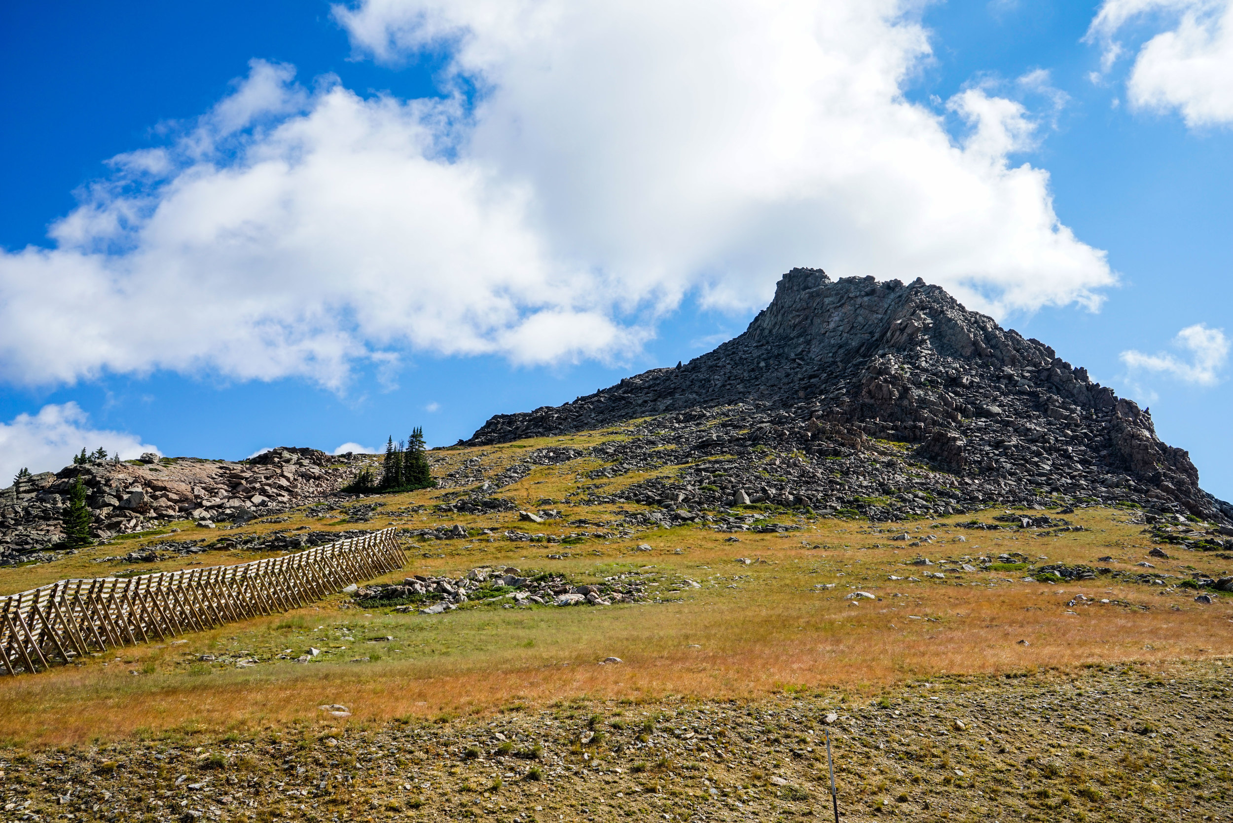 A picture of what we decided to climb up to get as high as we could. We tackle this from the west side of the photo, scrambling up large rocks and then eventually climbing to the high peak you can see in the center of the formation.