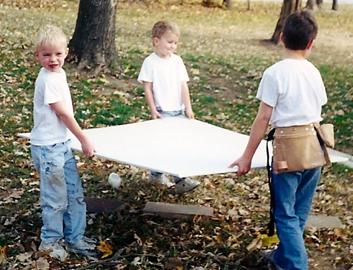 1999: Andrew, Peter and Ben carrying drywall for Rich.