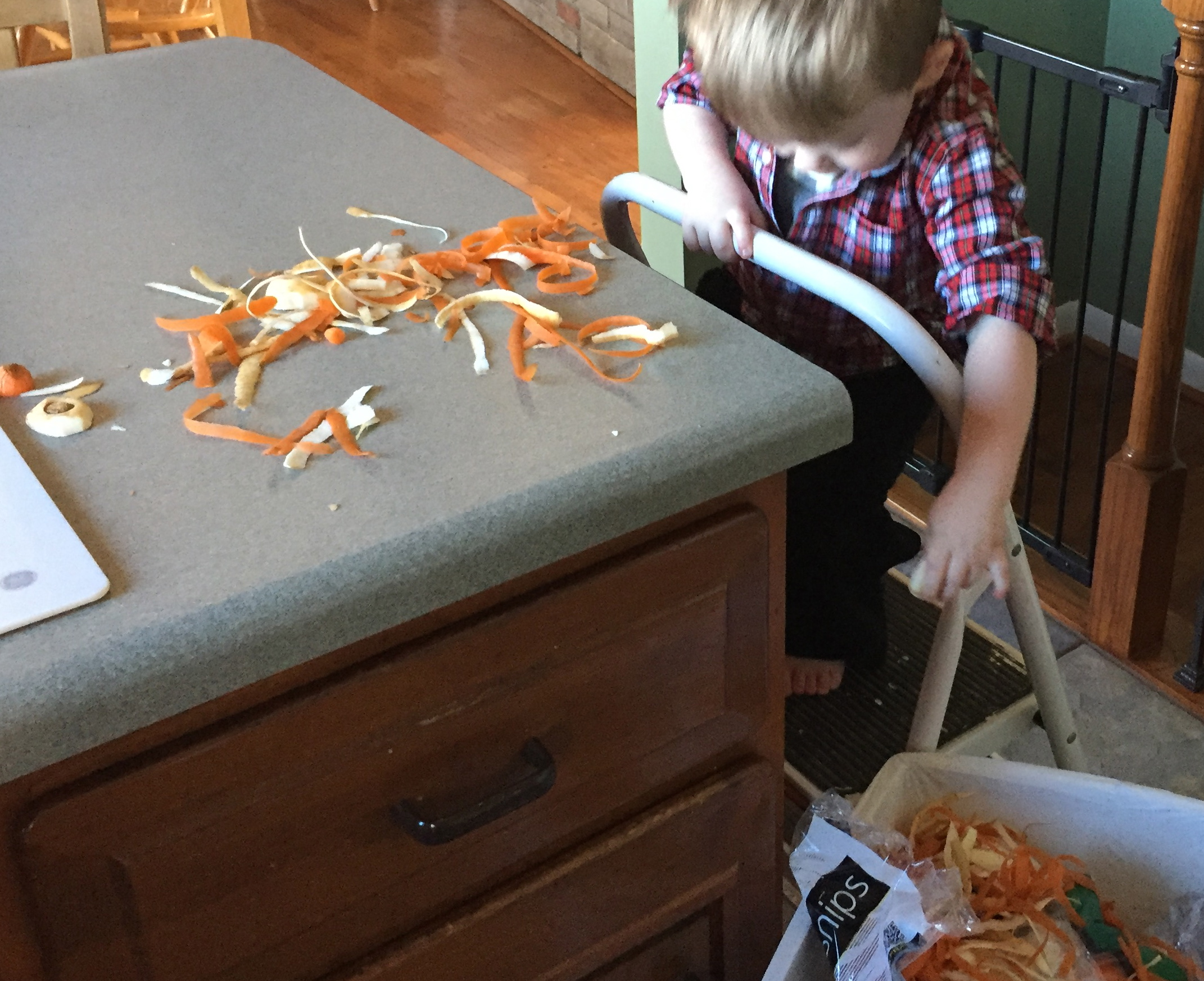 Helping clean up after peeling parsnips and carrots.