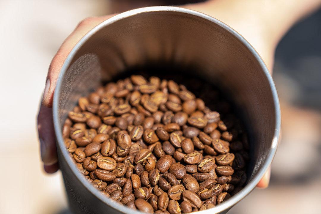 Atmos Full Coffee Beans Hand.jpg