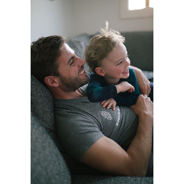 Sharing a secret or watching March Madness...who's to say? -  #portlandphotographer #pdxphotographer #letthembelittle #fatherandson #inpdx #portlandoregon #westcoast #photographyeveryday #instagood #moment