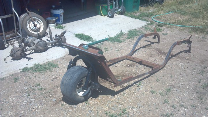 The remains of the 3 wheel golf cart after being stripped and extending the frame.