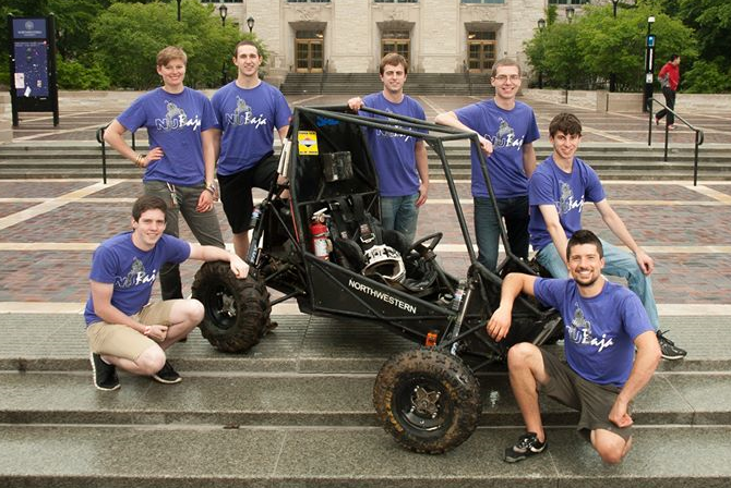 From left to right: Jared, Jane, Will, John, Ben, Mikey, and Mike, pictured with Spot in front of NU's Tech Institute