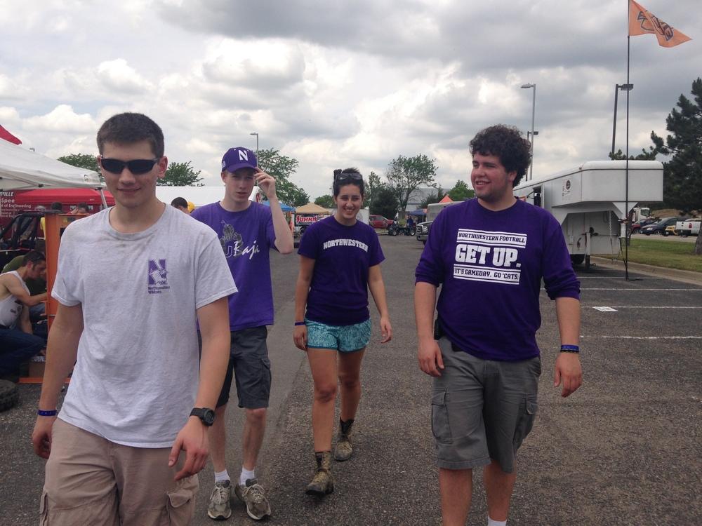 Isaac, Matt, Sarah, and Mickey walking around looking at all other teams'Baja cars