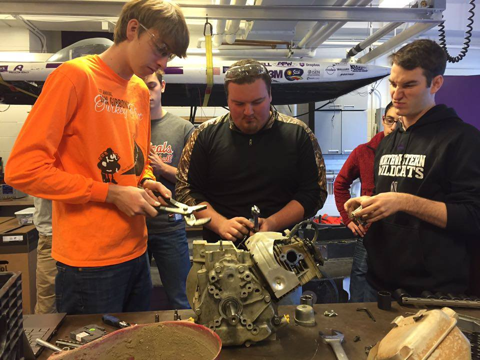 Spencer, Colton, and Eric making progress on the engine (see Eric's face for summary)