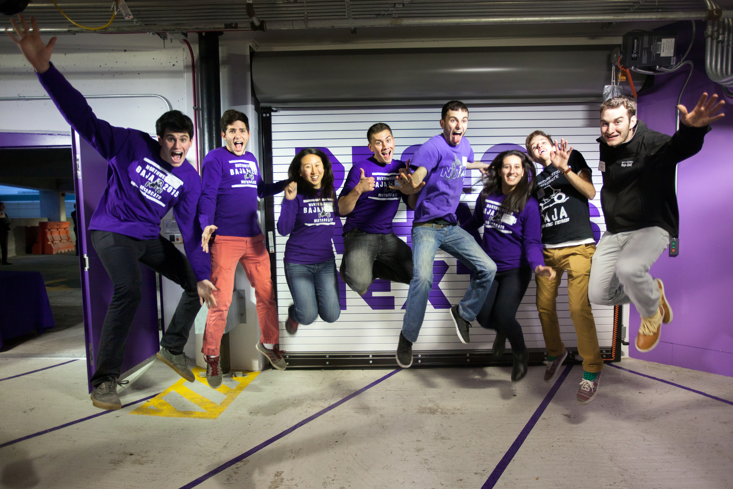 Members of the team jump for joy at the Garage Opening in November 2015
