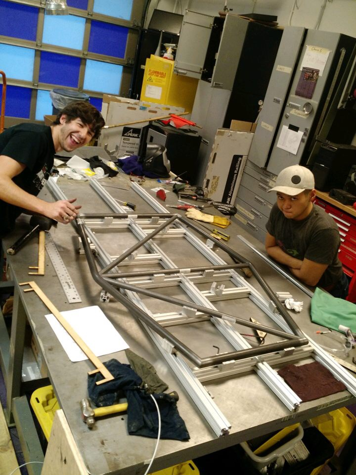 Armando and George persuading the rear roll hoop to fit properly.