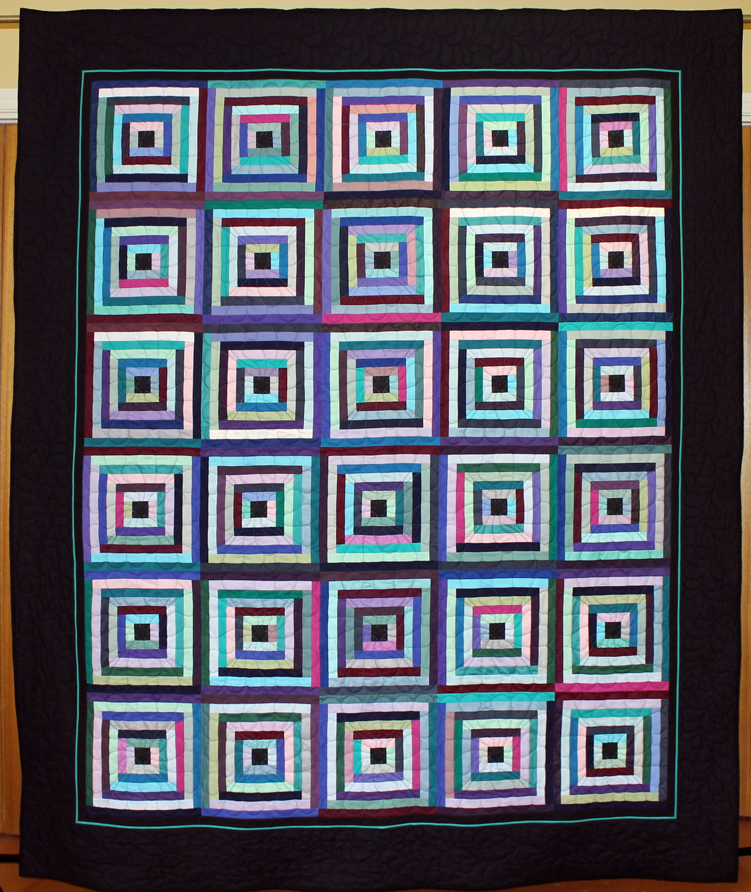 """""""Making Do"""" is machine pieced and machine quilted. I wish you could see the wonderful feather borders. The quilt is 84"""" x 100"""" and has the new Hobbs Tuscany Cotton/Wool batting."""