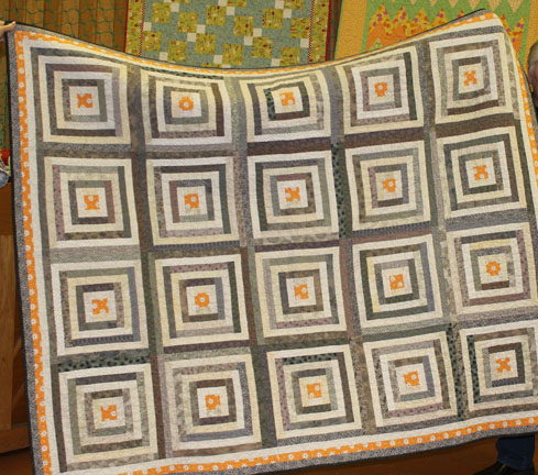 Log Cabin Renovations  was machine pieced by me and machine quilted by Lynn Jones.
