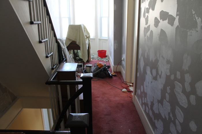 """Looking towards the """"bump"""", the walls are prepped, just need sanding and they will be painted the same lovely yellow as downstairs. The carpet is gone now and it is so much brighter."""