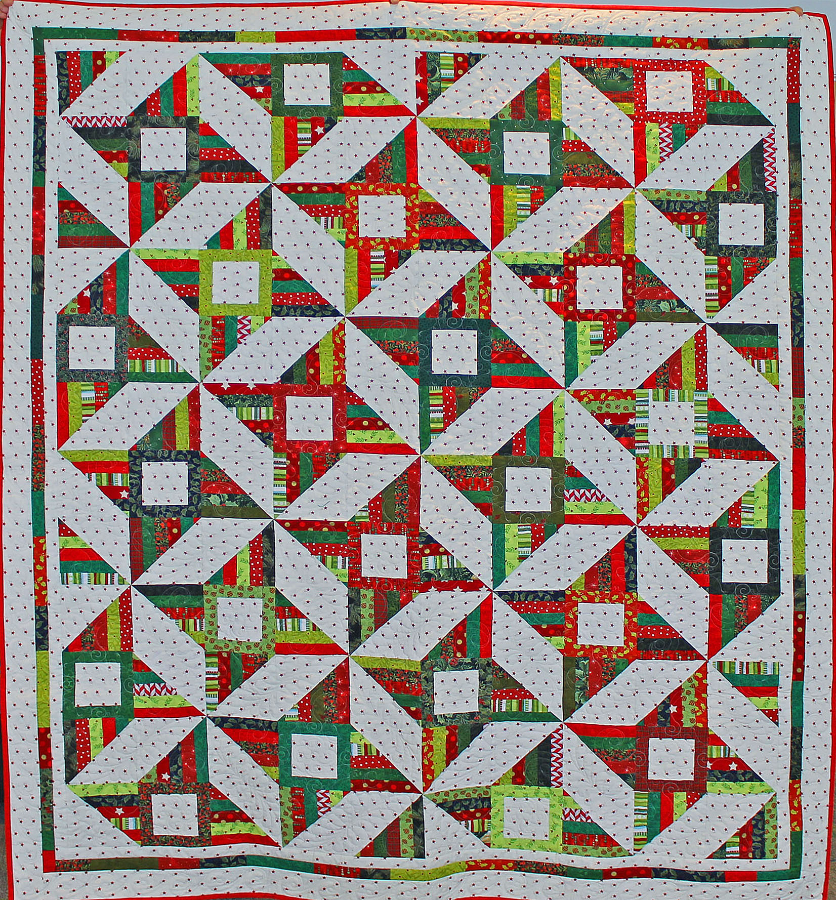 Merry & Bright  , a pattern by Corey Yoder, she called the quilt  Persimmon,  but since I used all Christmas fabrics I changed the name! All the fabrics were from my stash, it is machine pieced and machine quilted by Lynn Jones.