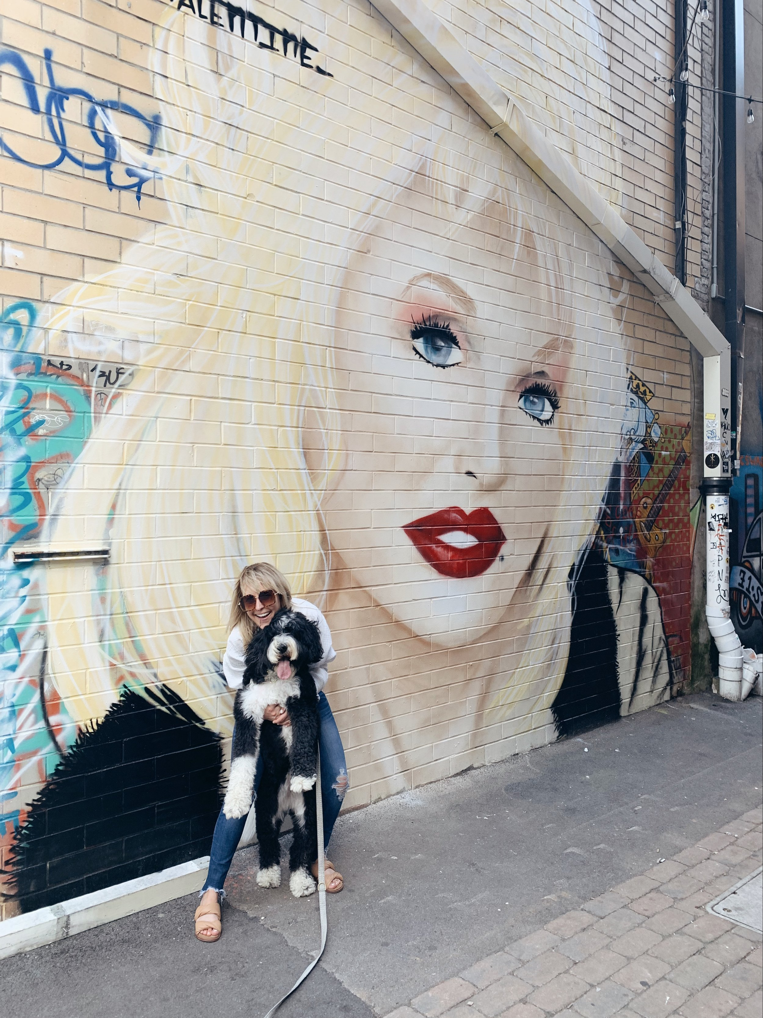 Dolly Parton is one of the first to greet you as you stroll into Strong Alley