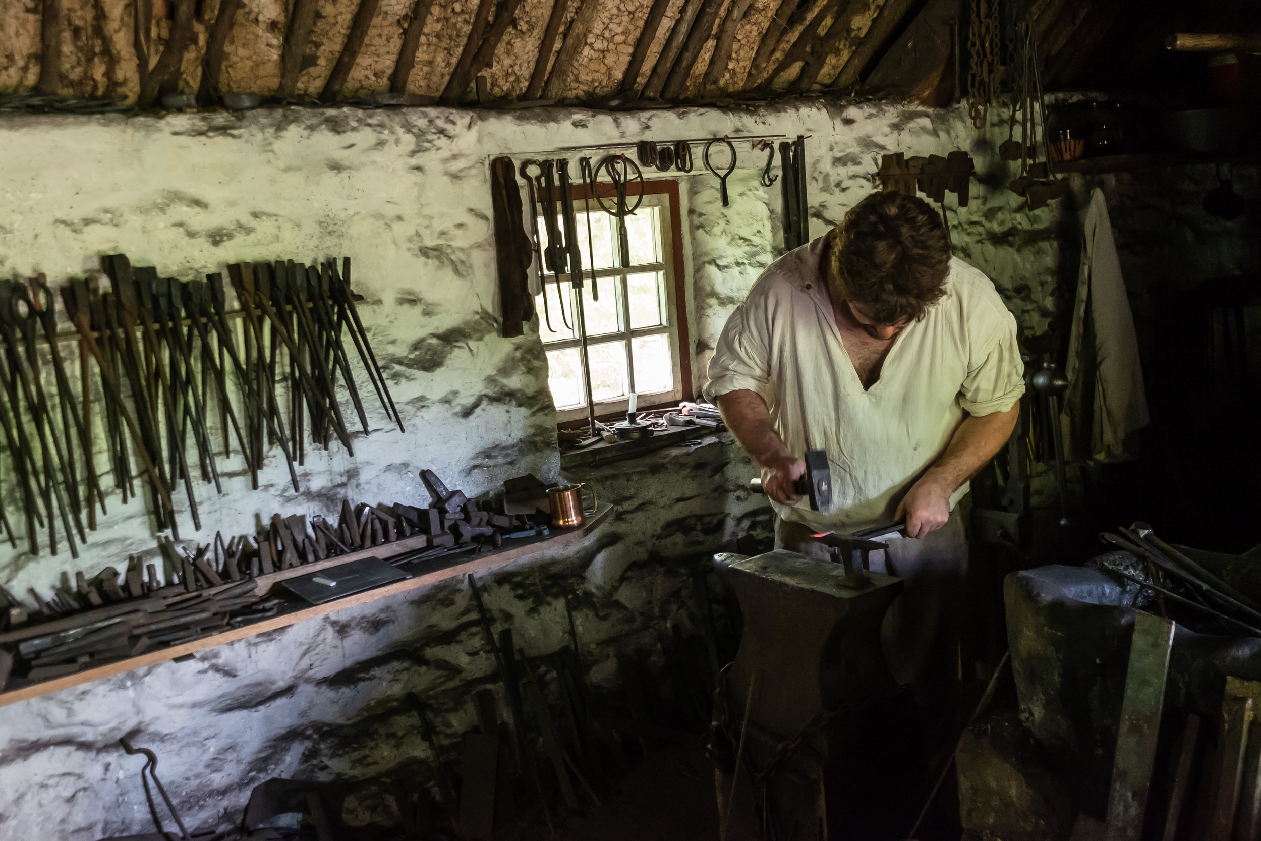 A working blacksmith at the Frontier Culture Museum