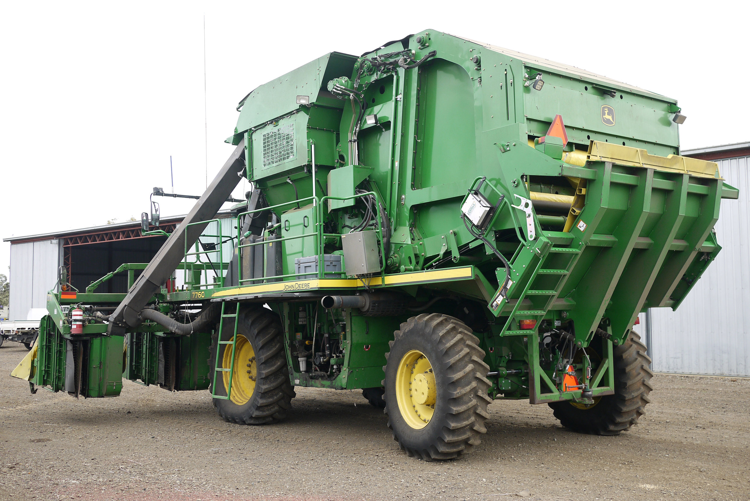 "John Deere 7760 round baler with rear steering axle extended to 3m (120"") centres"