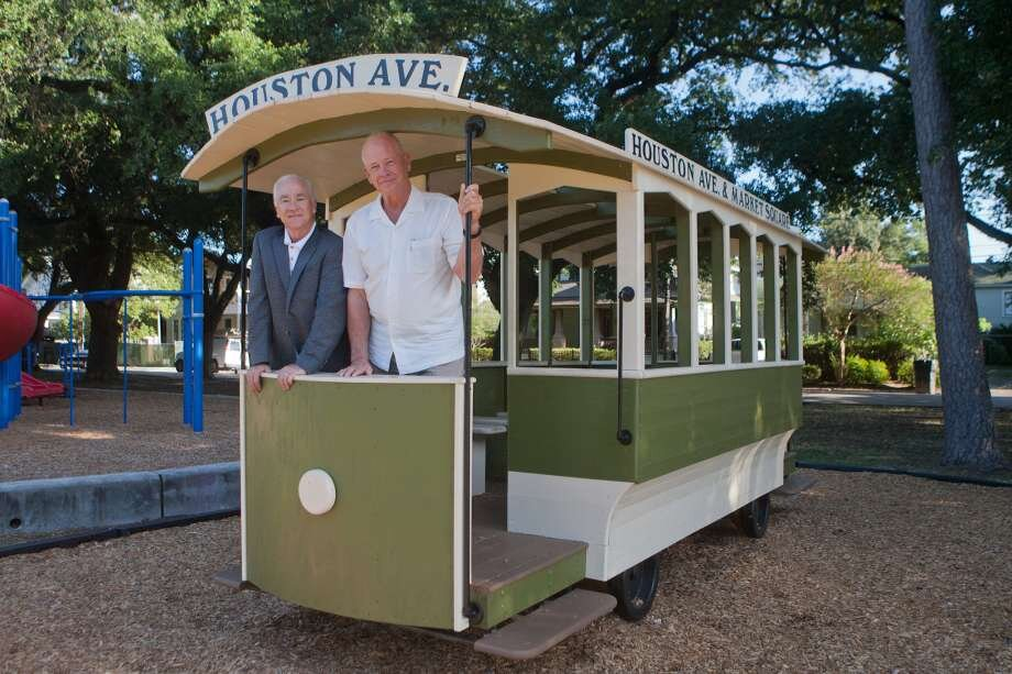 Pat Rutledge (Friends of Woodland Park) and Paul Carr, who made the trolly, when it was installed in 2016.  Photo courtesy of The Houston Chronicle.