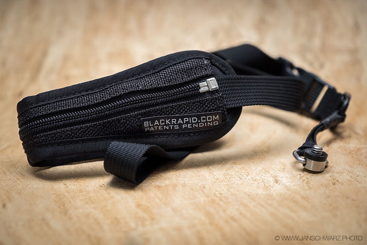 The strap from the BlackRapid SnapR 35 bag.