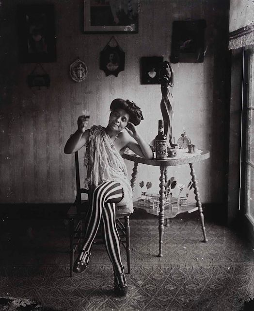 A prostitute in New Orleans circa 1912. Striped pantyhose were great eyecatchers