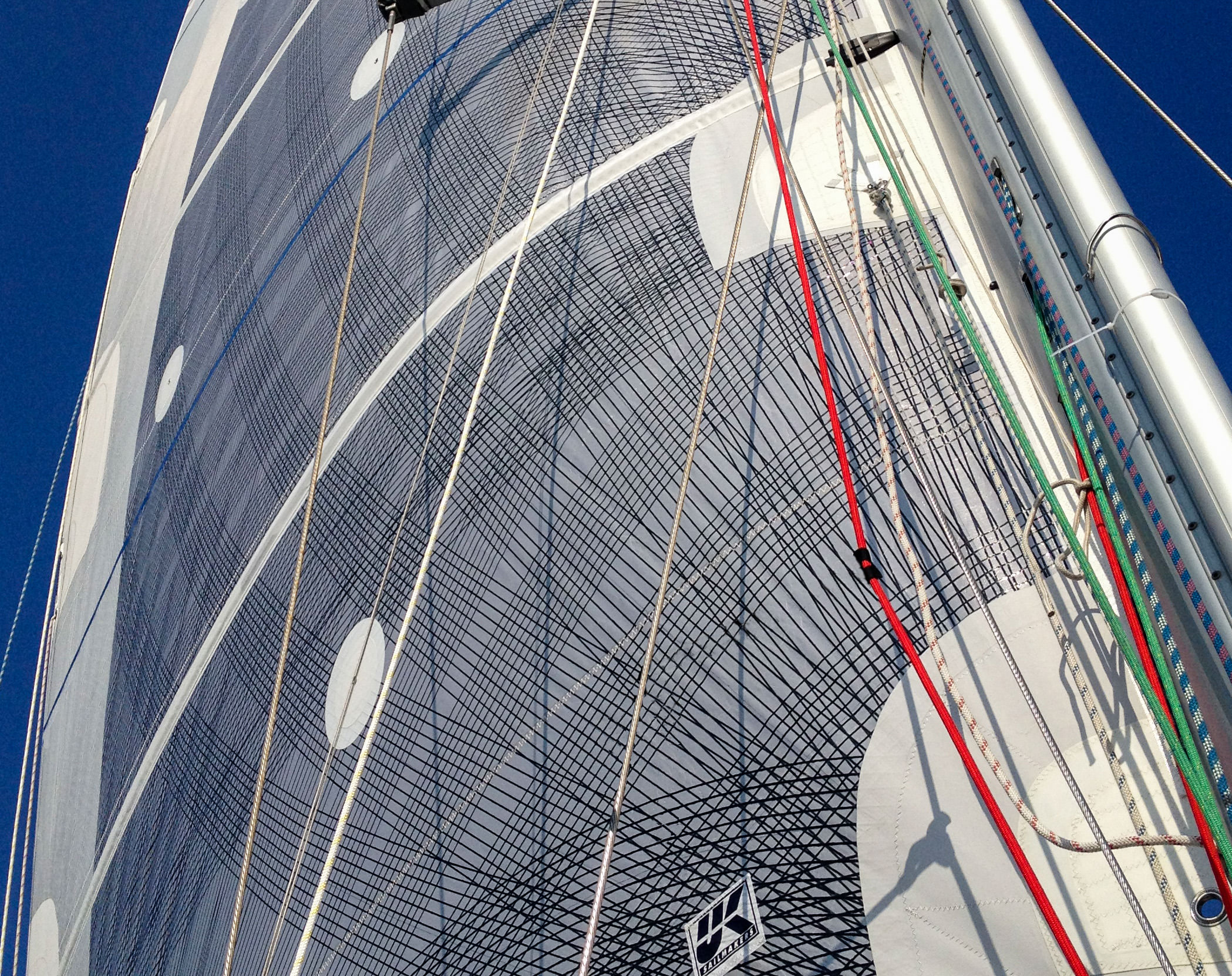 An example of the nearly full coverage of carbon fibers on a mainsail.
