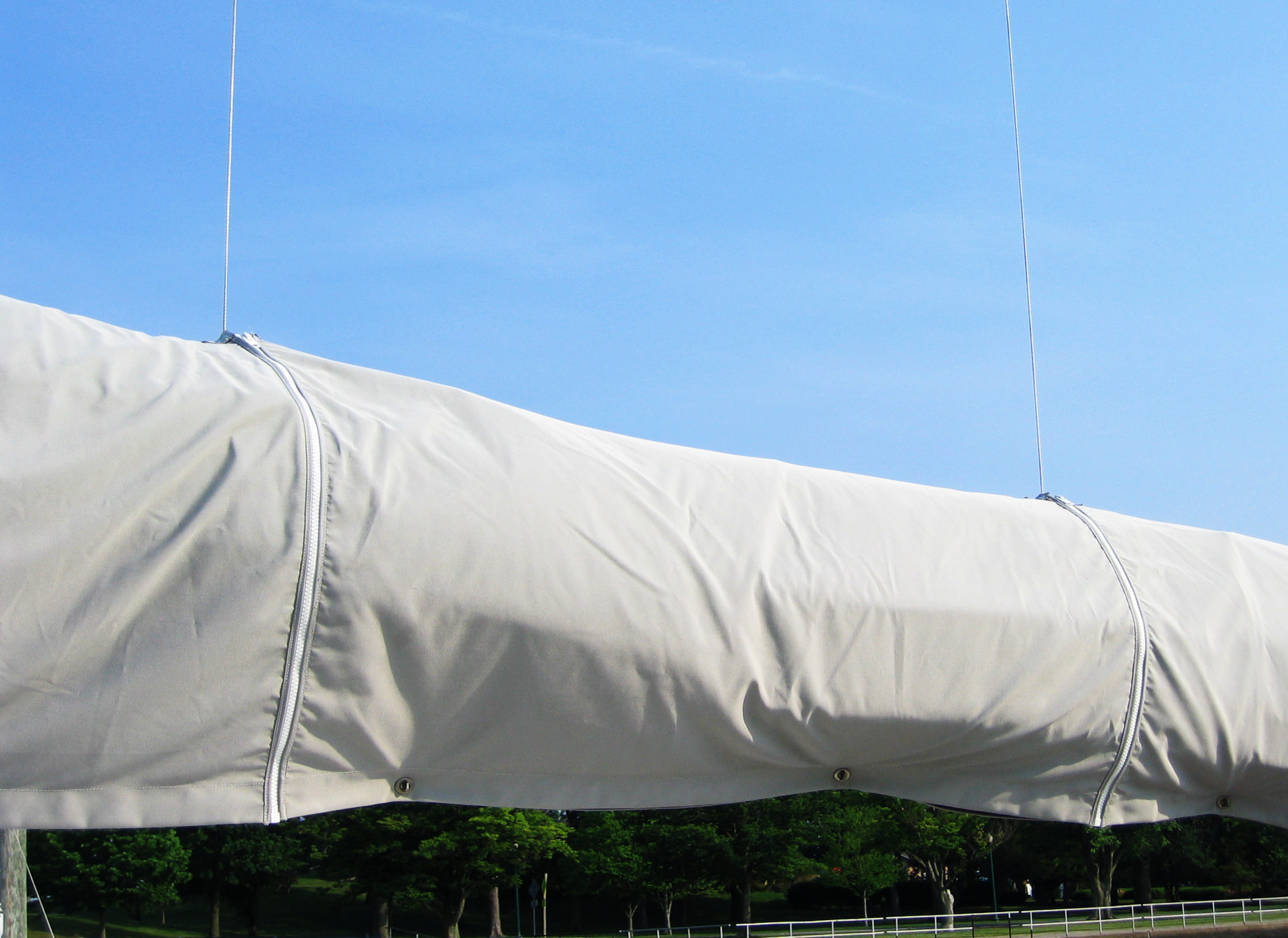 A close up of the carefully placed zipper slits in a mainsail cover.