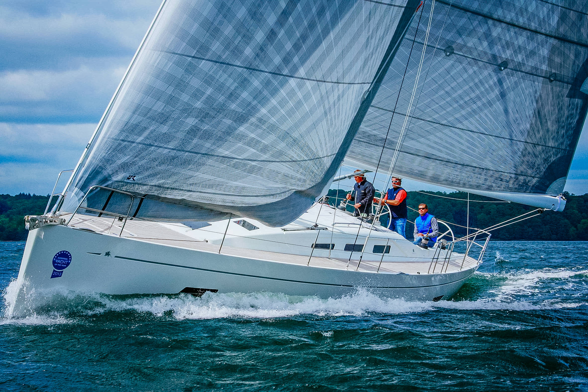 An Italia 13.98 with X-Drive taffeta carbon cruising sails. Click to enlarge.