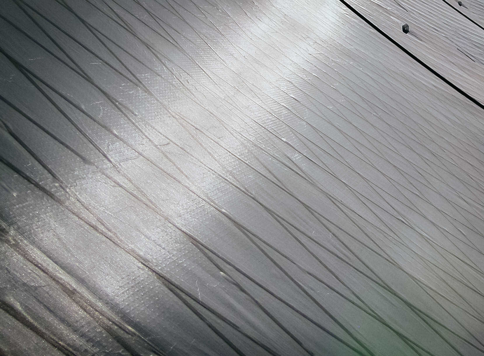 Grey taffeta over carbon tapes