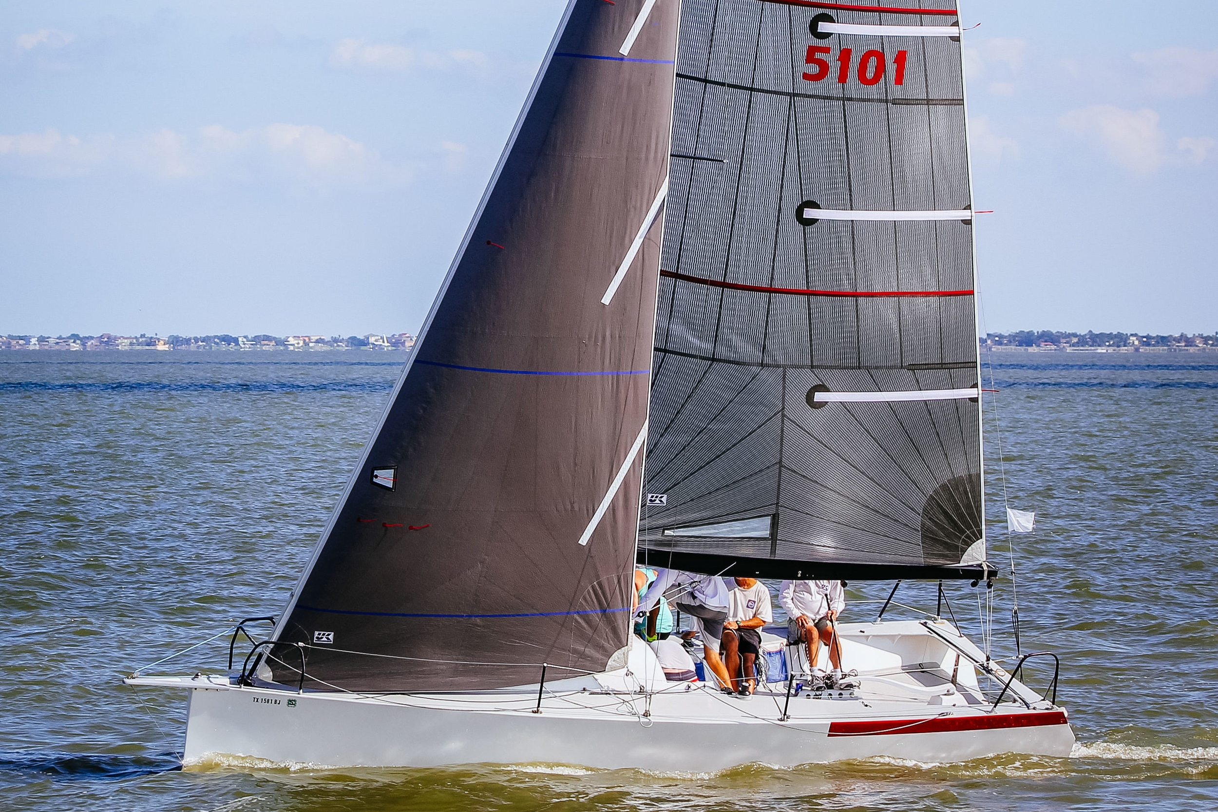 Radial Carbon Laminate   Description:  Tri-Radial panel layout   Construction:   Long narrow panels radiating from the three corners that attempt to follow the loadpaths between the corners. The straight fibers in each panel are discontinu-ous because they are cut on every seam unlike our X-Drive and Titanium sails.   Material:  Warp-oriented carbon laminates   Shape Stability:  ★★★★   Shape after 500 hours:  Circa 70%   Price:  $$$$