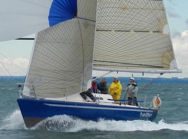 The IMX 38 Five-Fifteen blasting downwind.