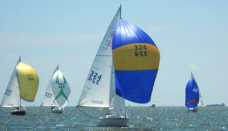 Jonathan Baker leading the fleet downwind with his UK Sailmakers Matrix spinnaker.