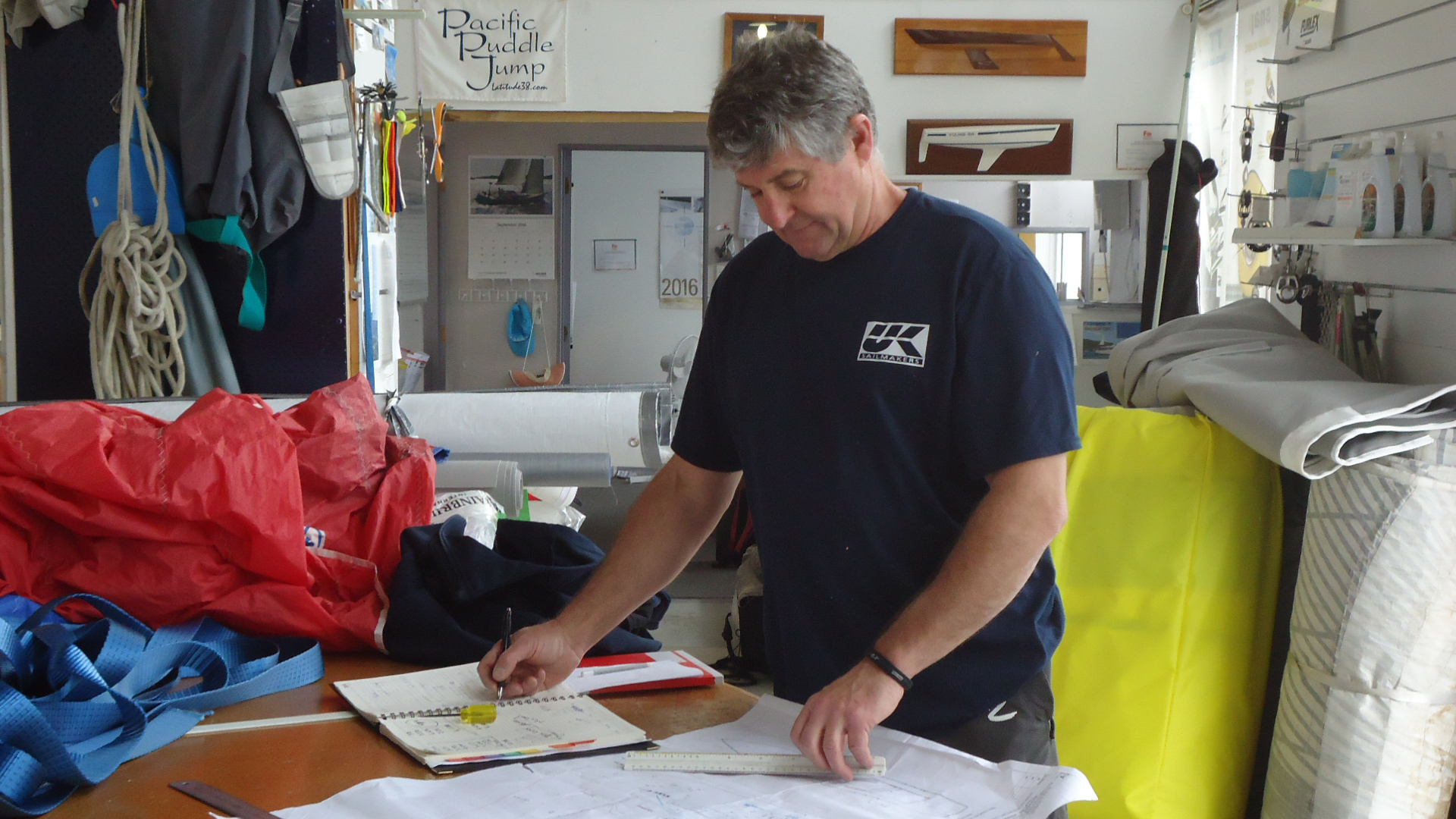 """Phil """"Phizzle Houghton planning out a new set of sails."""