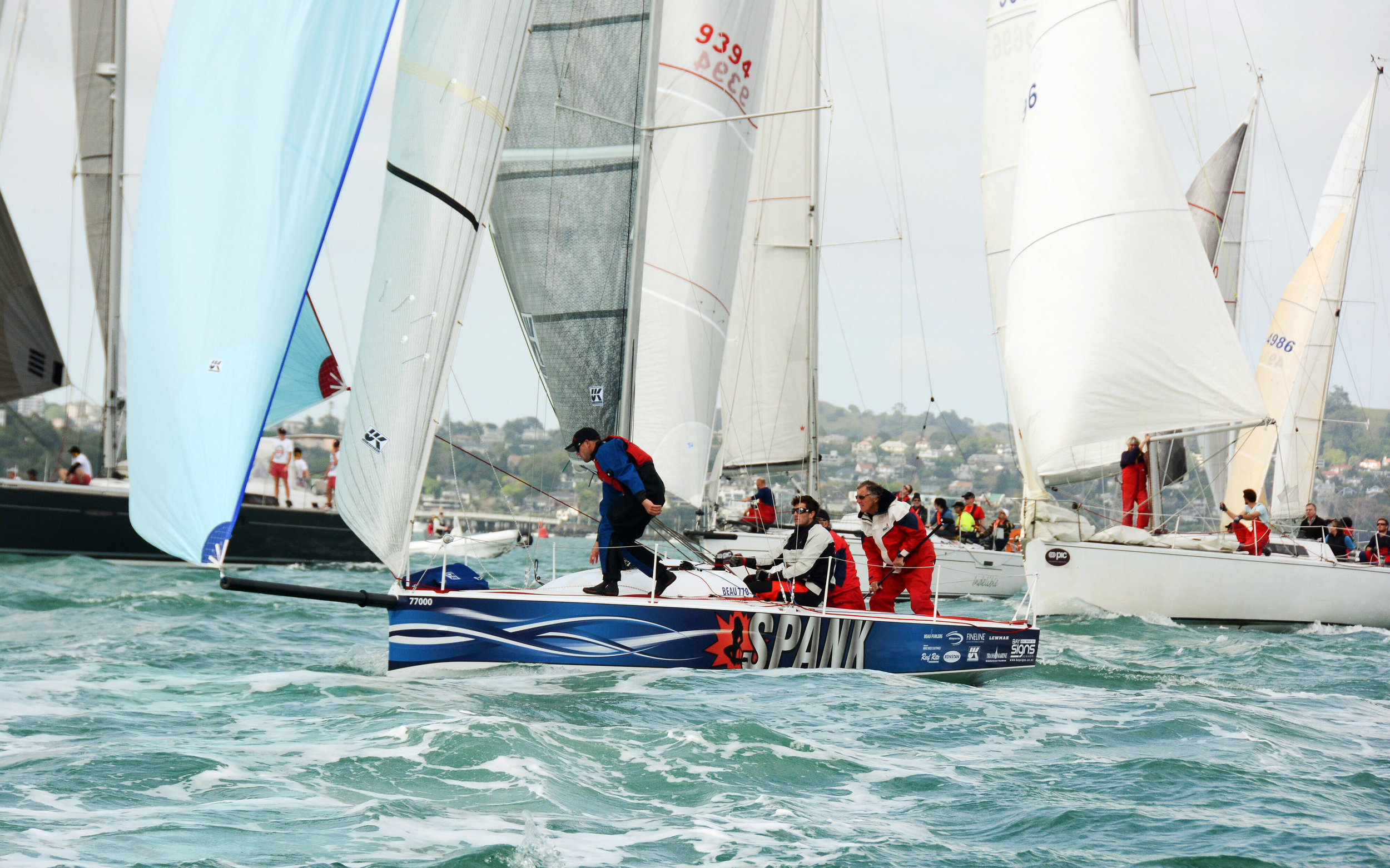 SPANK racing with her UK Sailmakers Titanium main, Tape-Drive genoa and asymmetrical spinnaker.