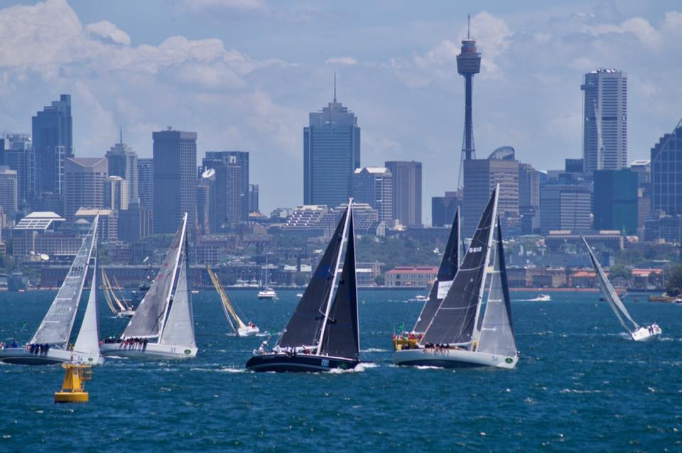 TRIPLE LINDY (dark blue hull) leading her class just after the start of the 2017 Sydney Hobart Race. Duff Paisley photo.