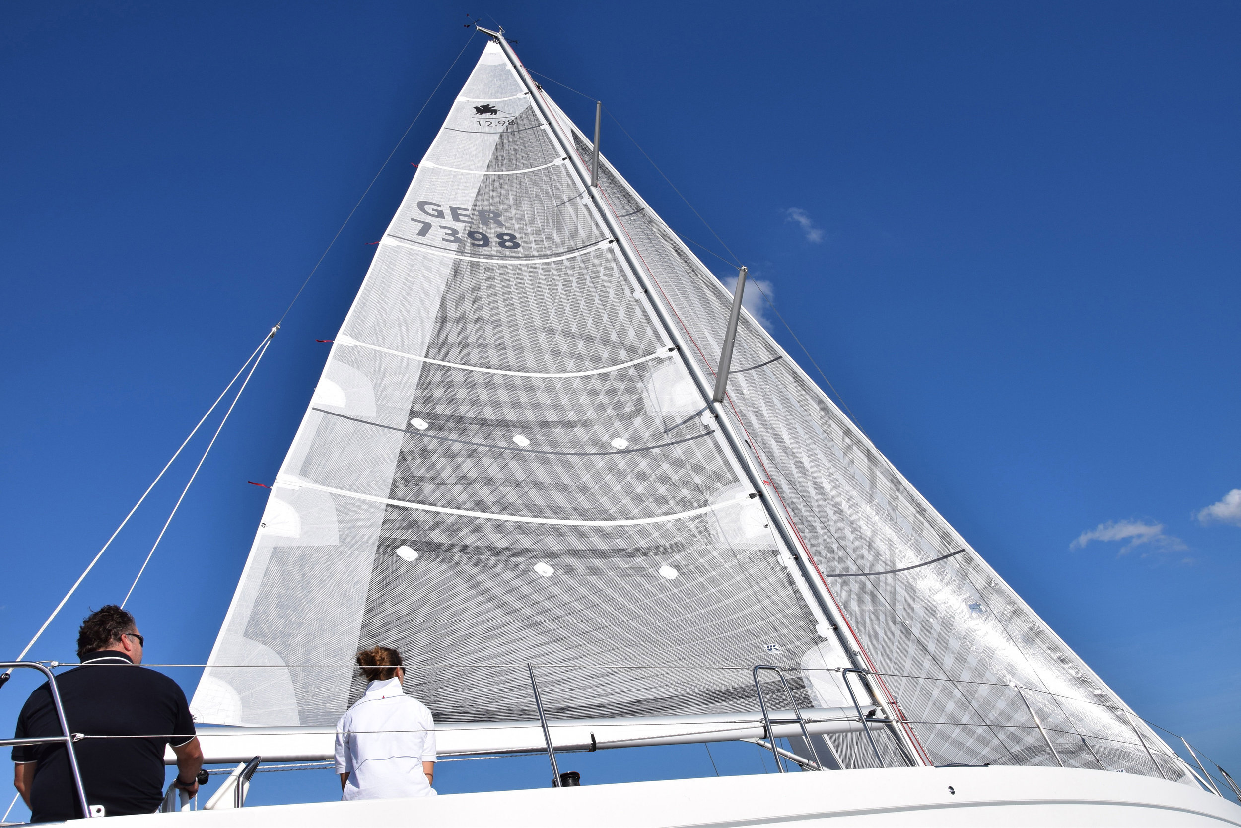 Carbon X-Drive on a polyester/mlyar base laminate that has a taffeta layer (light-weight finely-woven polyester cloth) on the side opposite the carbon tapes. This mainsail has a one meter wide strip of taffeta over the mainsail leech for extra durability.