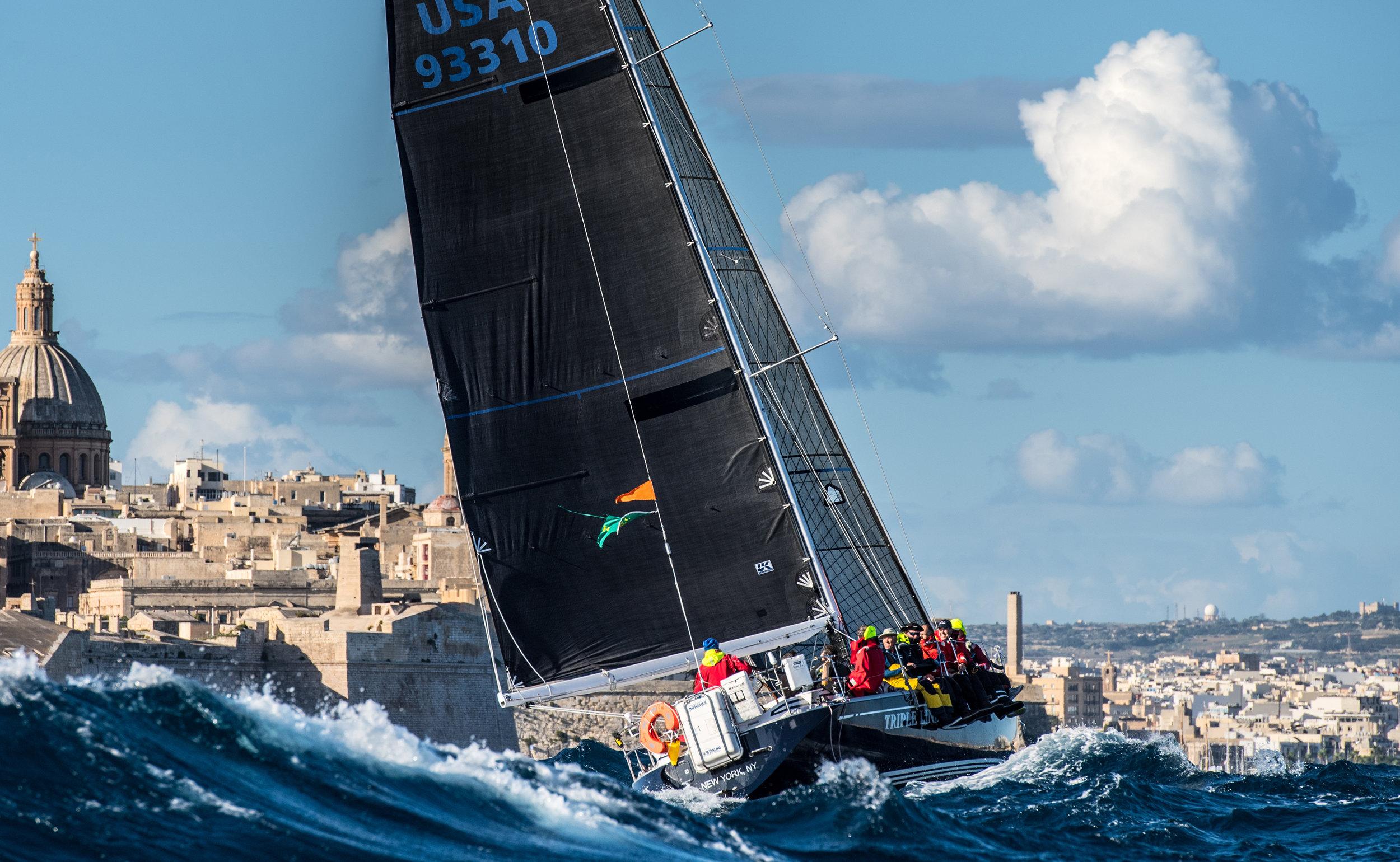 Photo of TRIPLE LINDY finishing the 2017 Rolex Middle Sea Race courtesy of Rolex/Kurt Arrigo.