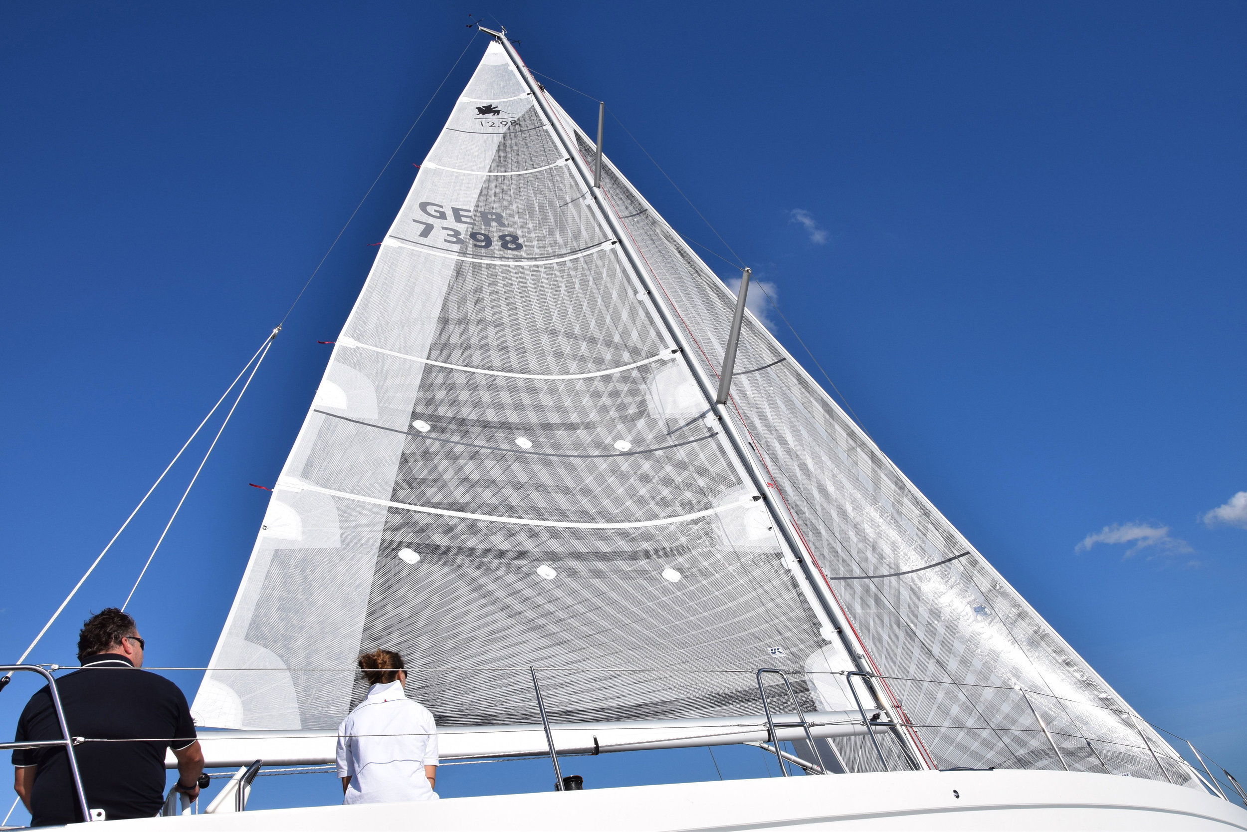 An Italia 12.98 with X-Drive carbon full-batten mainsail and roller/furling genoa. The base laminate has a white taffeta on the side opposite the fibers, while the main has taffeta applied over the fibers on the leech for extra durability.