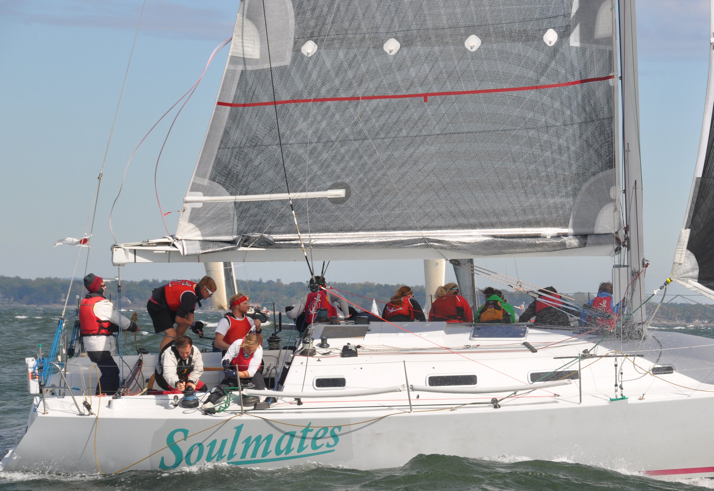 Photo 1 : Notice how tight the reefed foot is. Just the normal outhaul gets pulled tight when he breeze it up to flatten the main, the reef outhaul has to be tight to flatten the sail.