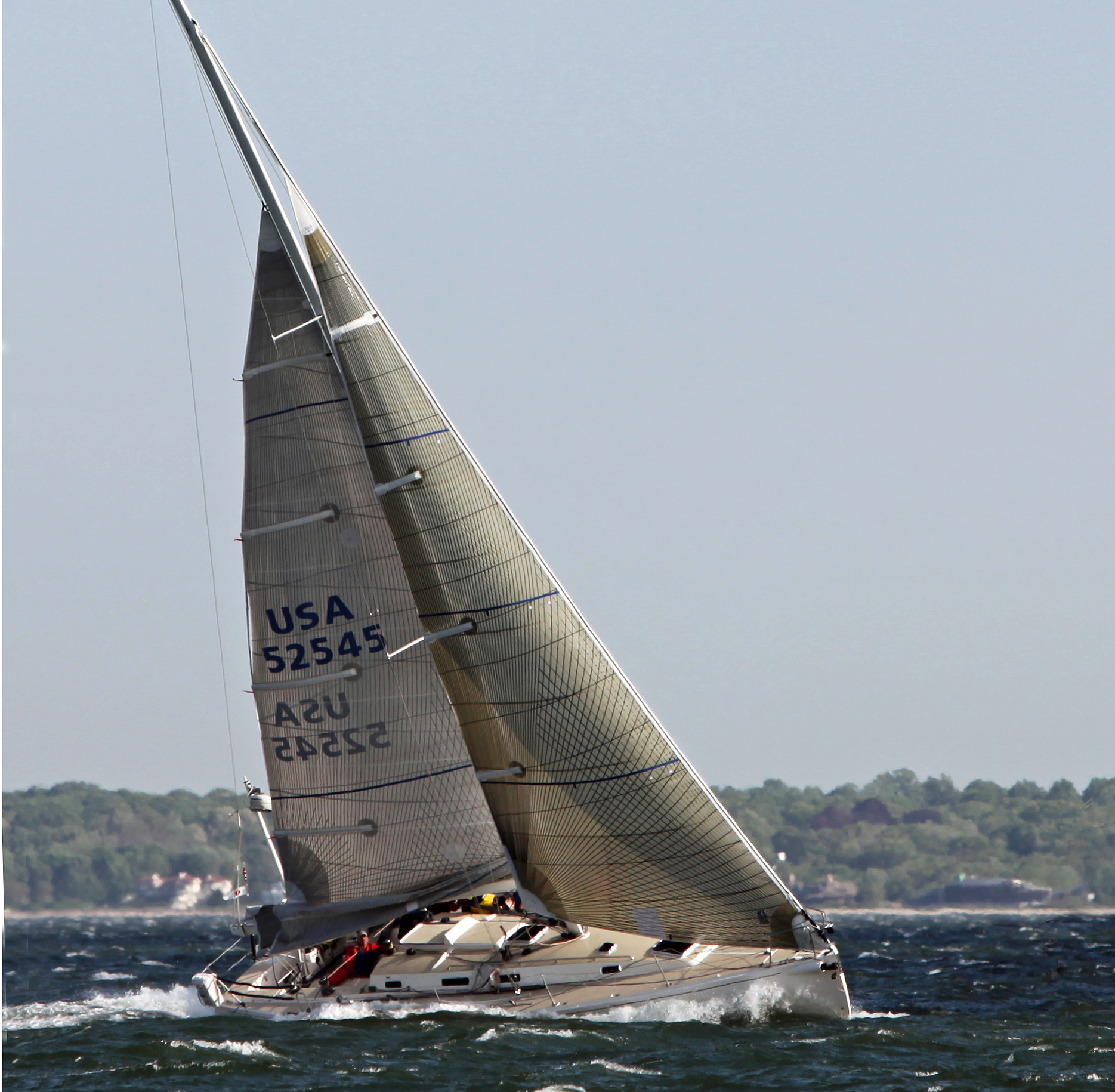 The J/133 Antidote with a double-reefed main and No. 4 genoa going to windward in 40 knots of wind. Allen Clark image/www.photoboat.com