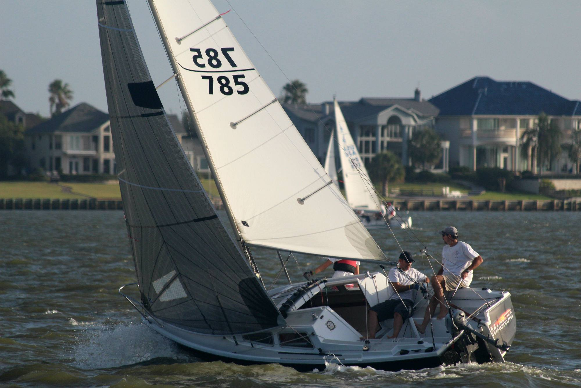 UK's racing genoa is a tri-radial construction made with either black aramid fibers or black polyester fibers.