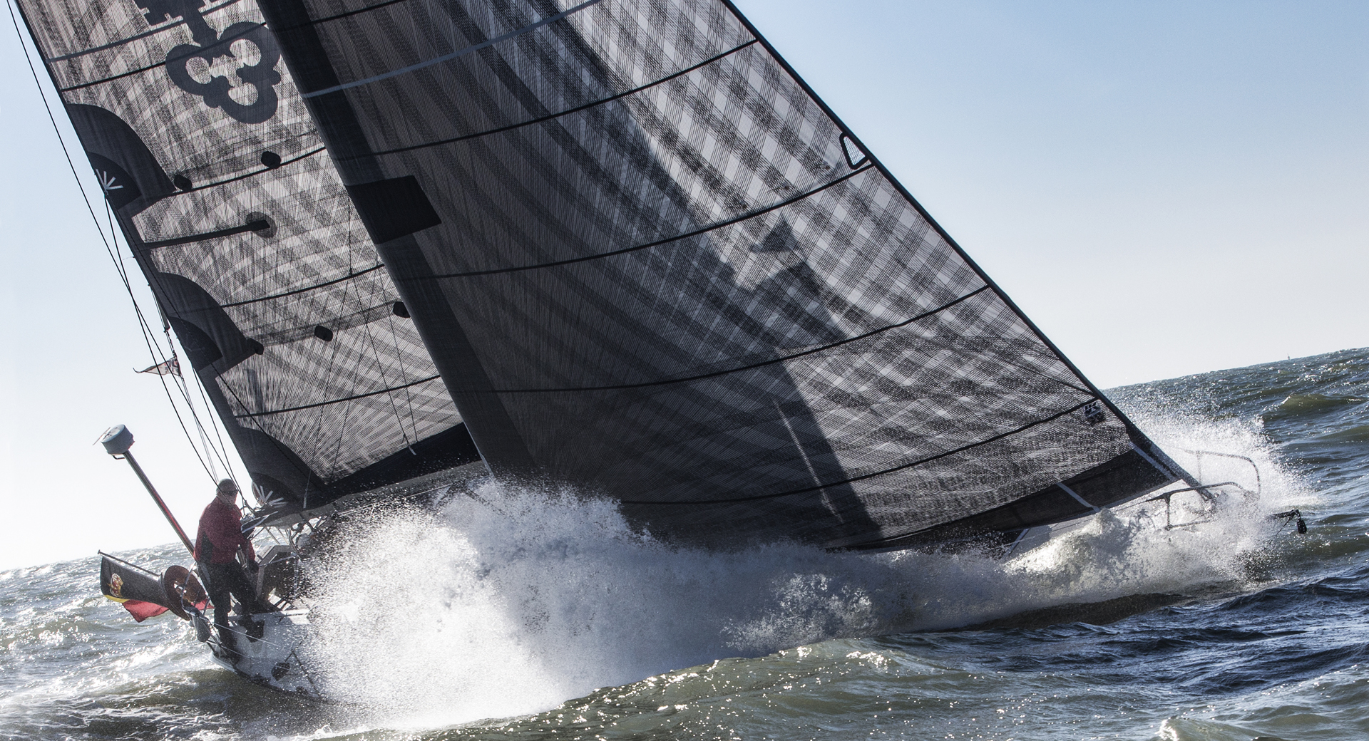Depending on the boat size, performance level, weight and price, carbon X-Drive load-path fibers can be bonded to laminates reinforced with aramid scrims as shown above, or laminates reinforced with polyester scrims. Both laminates can gain chafe protection with a taffeta layer; the extra longevity comes at the price of extra weight and cost.