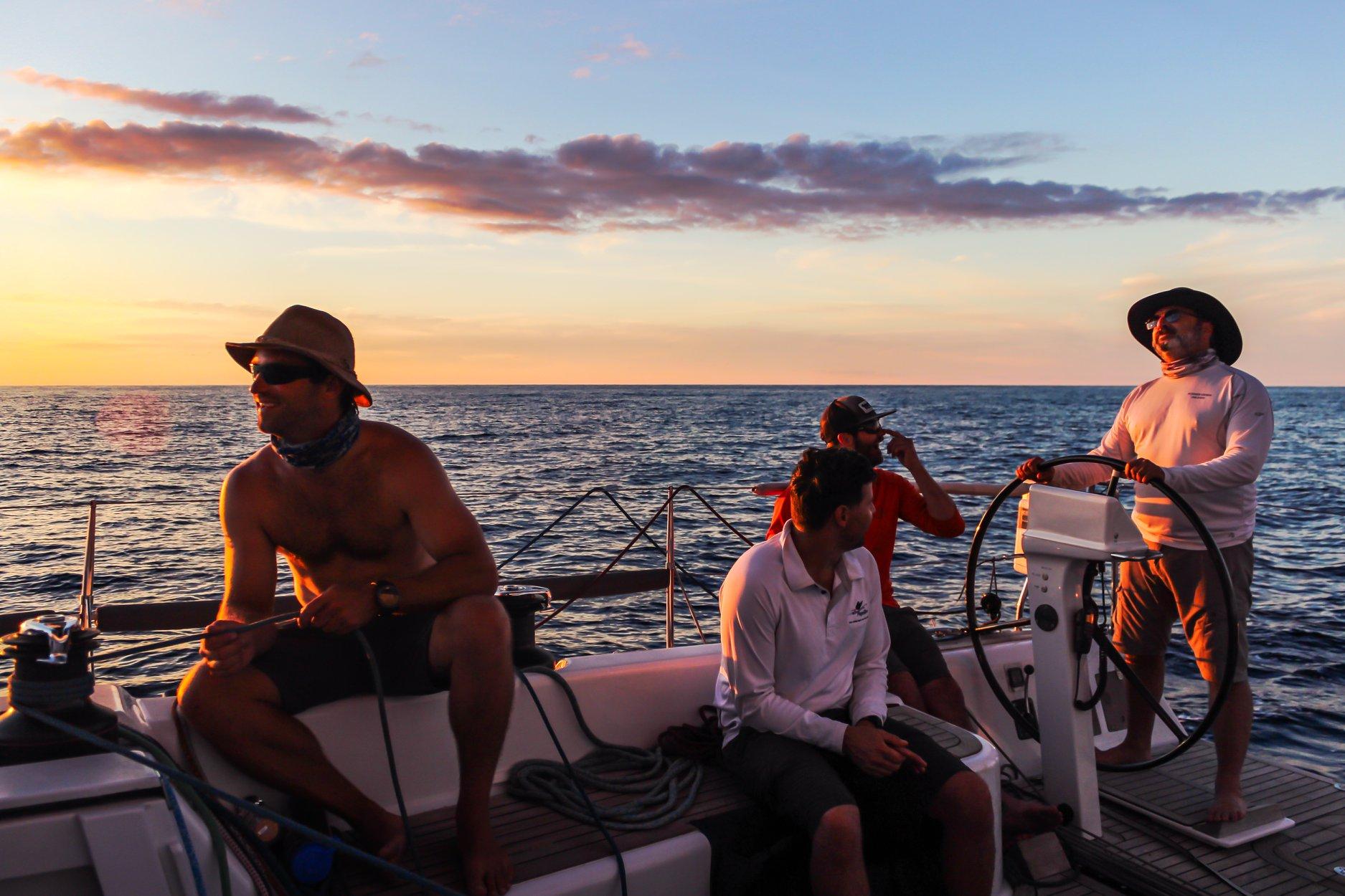 Light winds dominated the 2018 Newport to Bermuda Race. Shown here is the starboard watch on the Marten 49 SUMMER STORM. From the wheel forward: Andrew Berdon, Alden Winder, Ben Cormack, Walker Potts. Josh Reisberg photo.