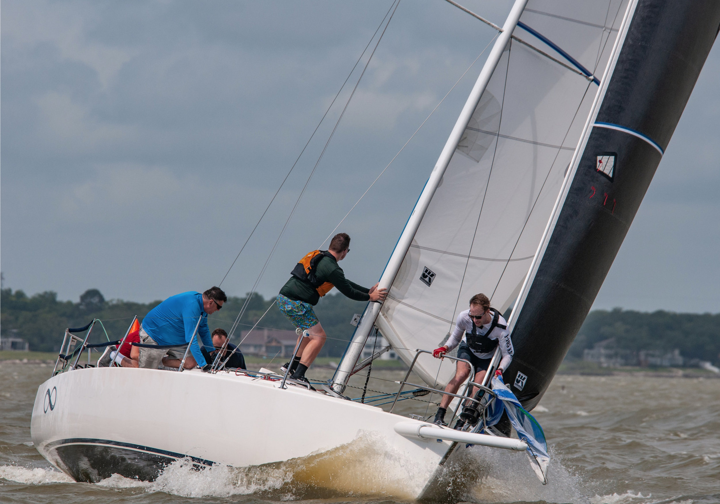 Photographer John Lever caught INFINITY going into a spinnaker set. Here jib is made with UK Sailmakers' Titanium LiteSkin construction.
