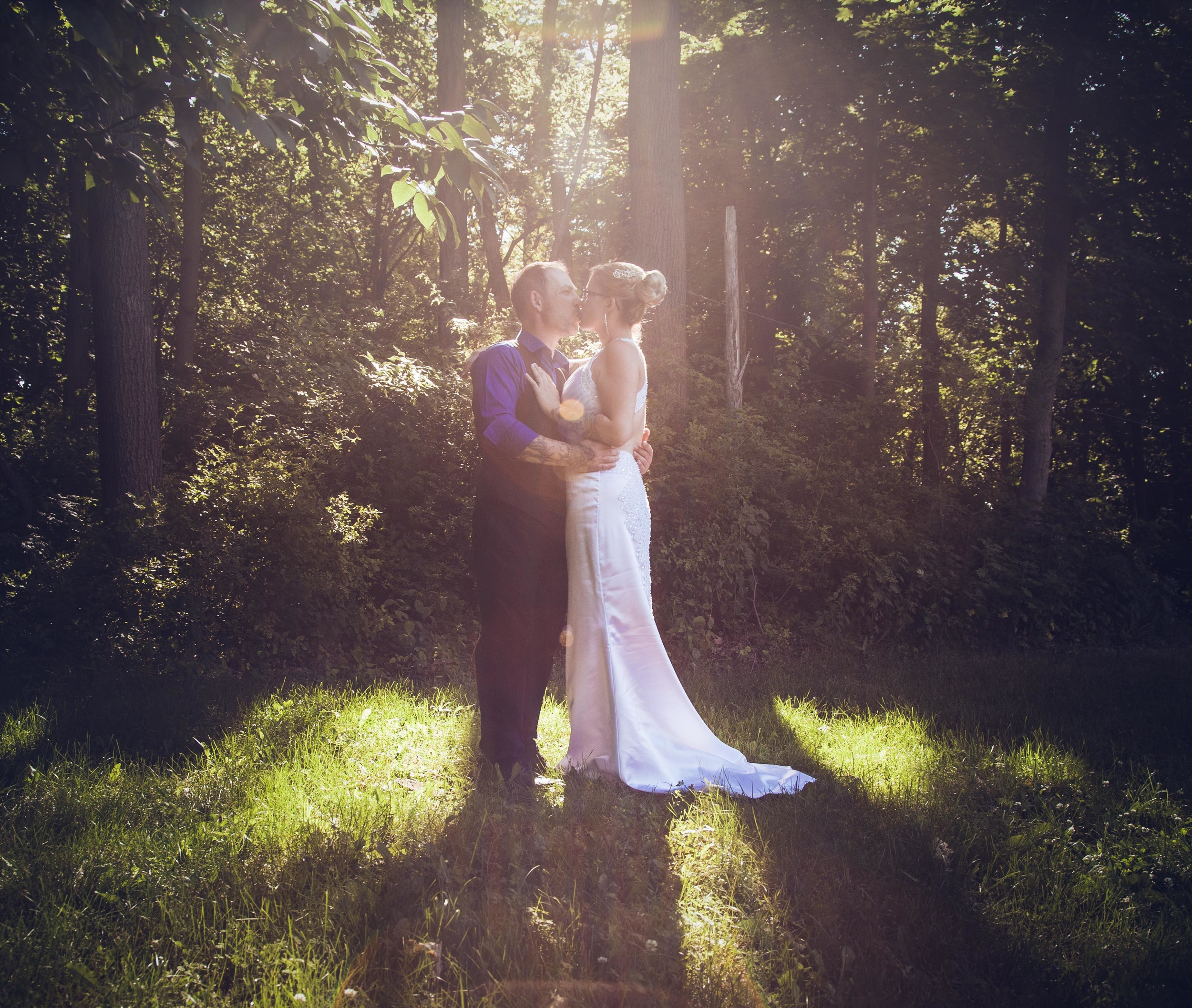 Couple in sunflare.  Magical fairytale
