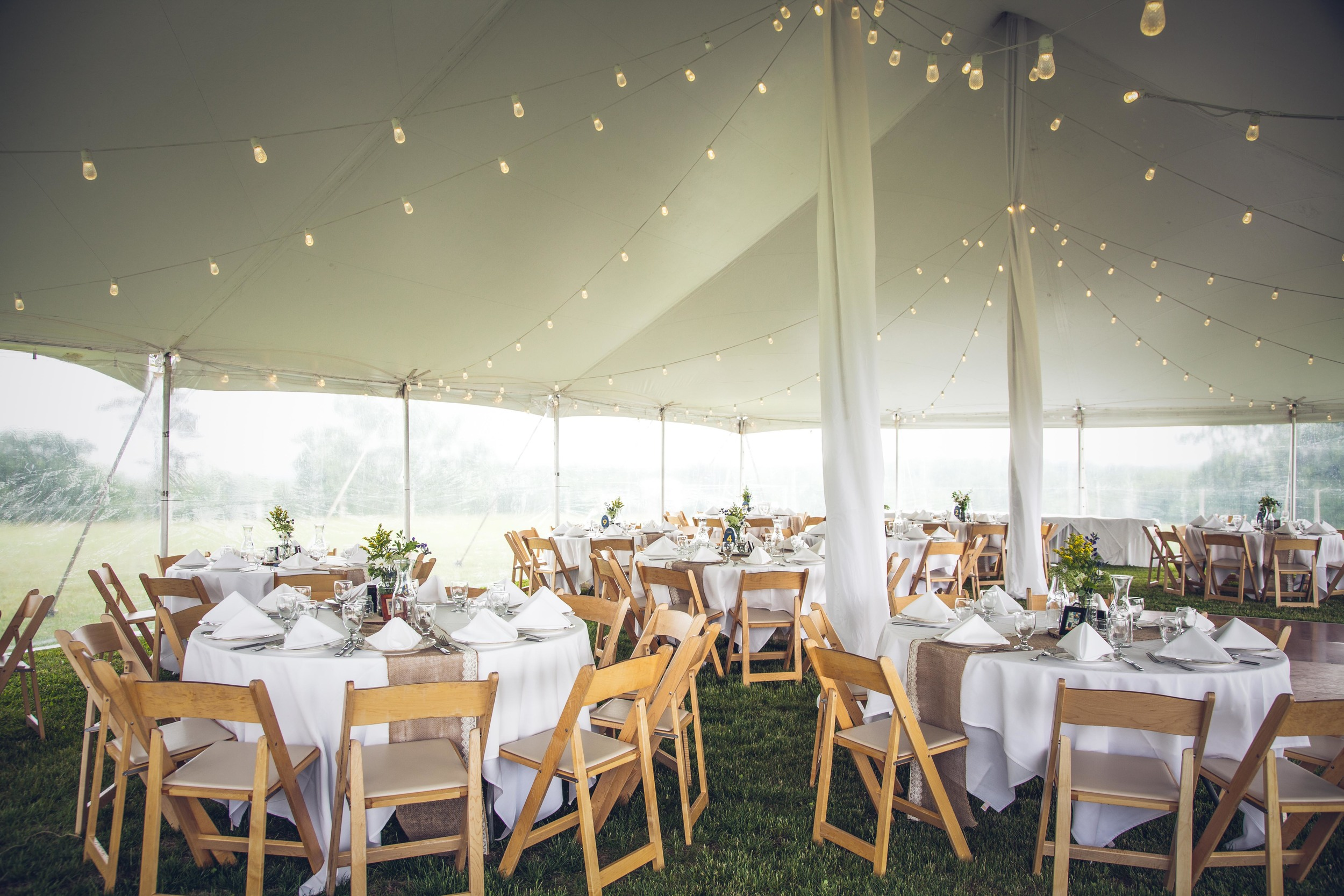Tent with tea lights and tables set up